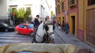 Traffic jam with horseless carriage in last place.