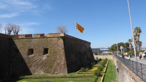 Flag of Catalonia flies from the castle at Montjuïc.